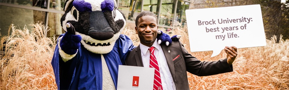 Boomer and a smiling graduate of Brock University at Convocation
