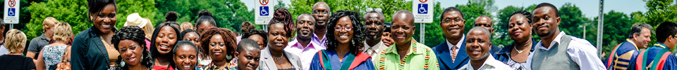 A Brock University graduate and her smiling family at a Convocation ceremony
