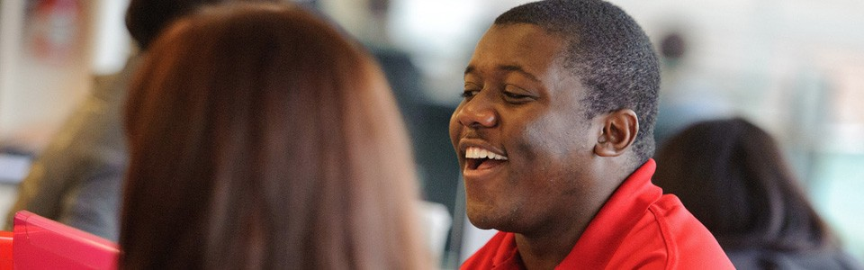 A smiling Brock University student