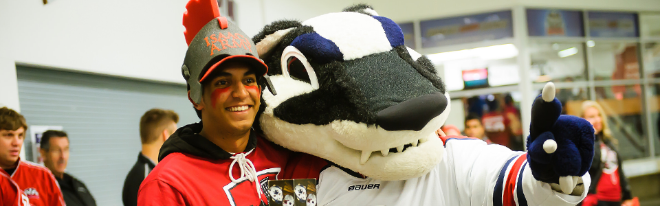 A smiling Brock Badgers fan and Boomer the Badger