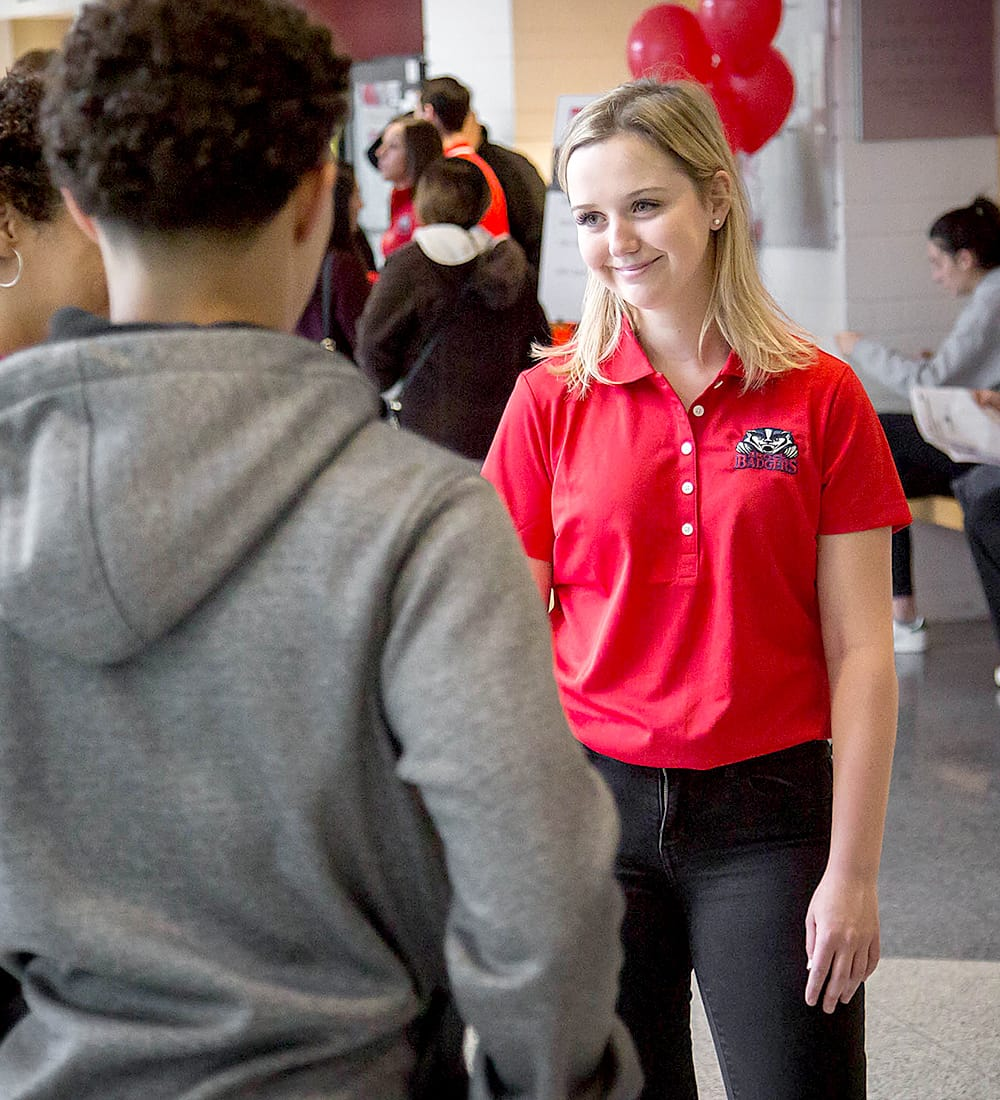 A Brock student volunteering at Open House