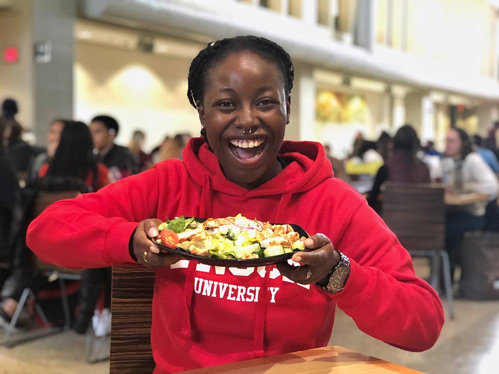 Student smiling with meal