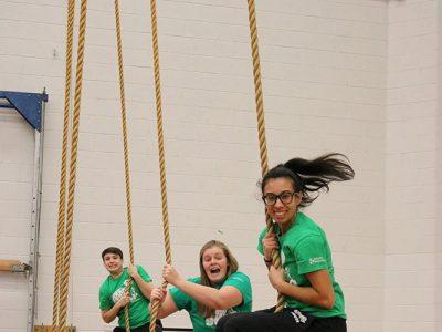 Students swinging on ropes