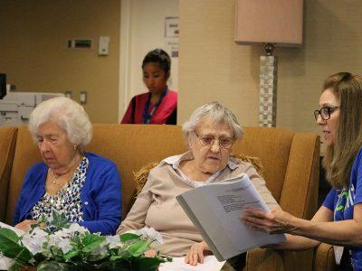 woman reading to senior