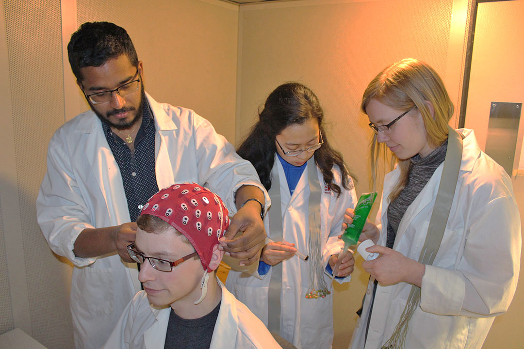 Neuroscience students conducting experiment