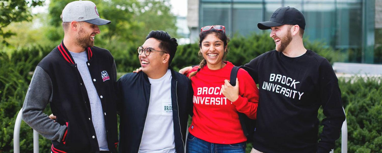four brock students walking together