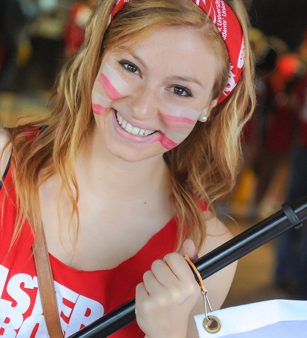 A smiling Brock student in red and white at Welcome Week