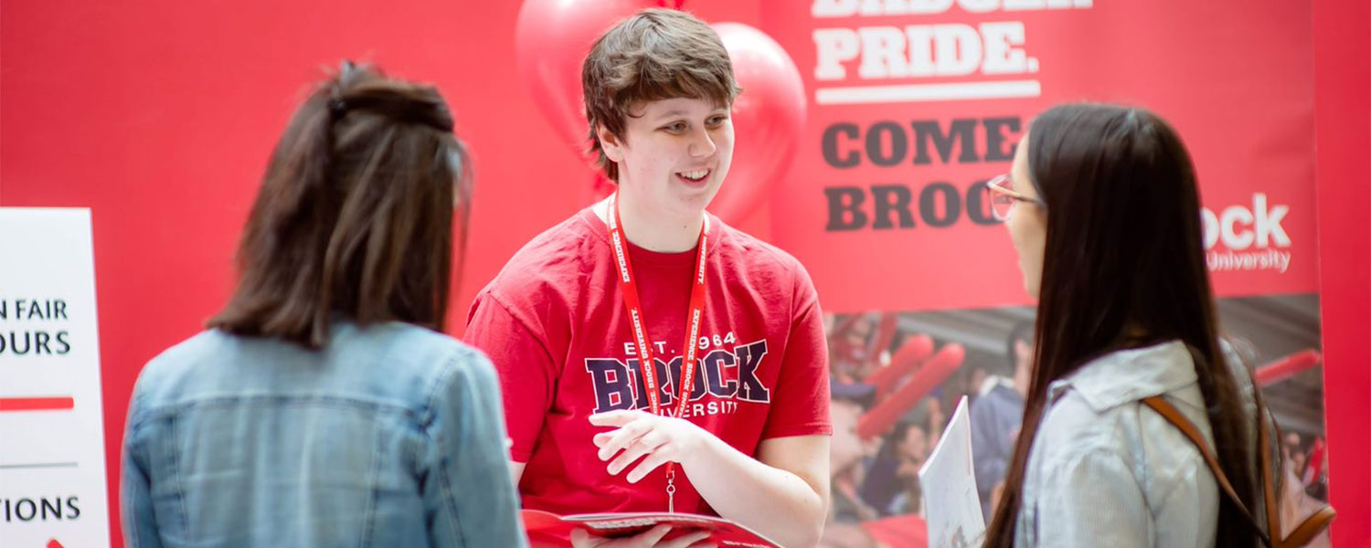 a Brock student talks to two prospective students