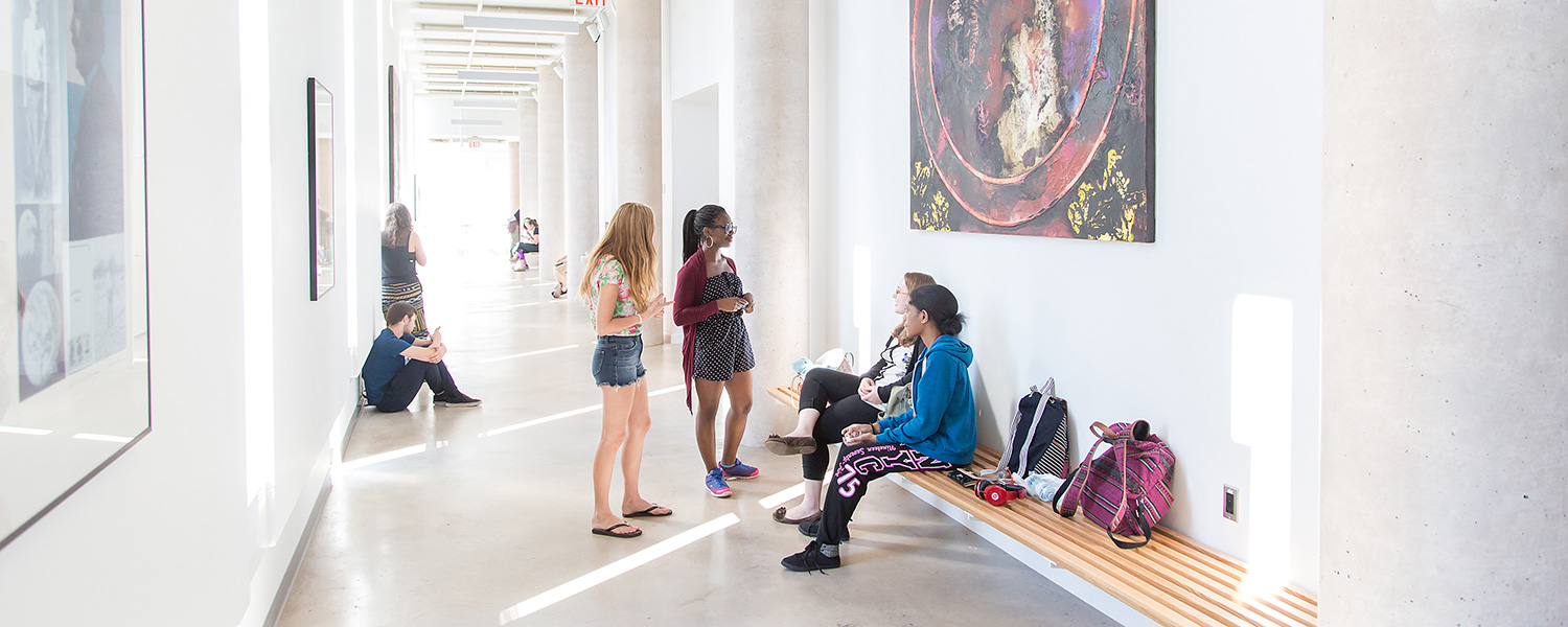 Students chatting in the hallway of the Marilyn I. Walker School of Fine and Performing Arts